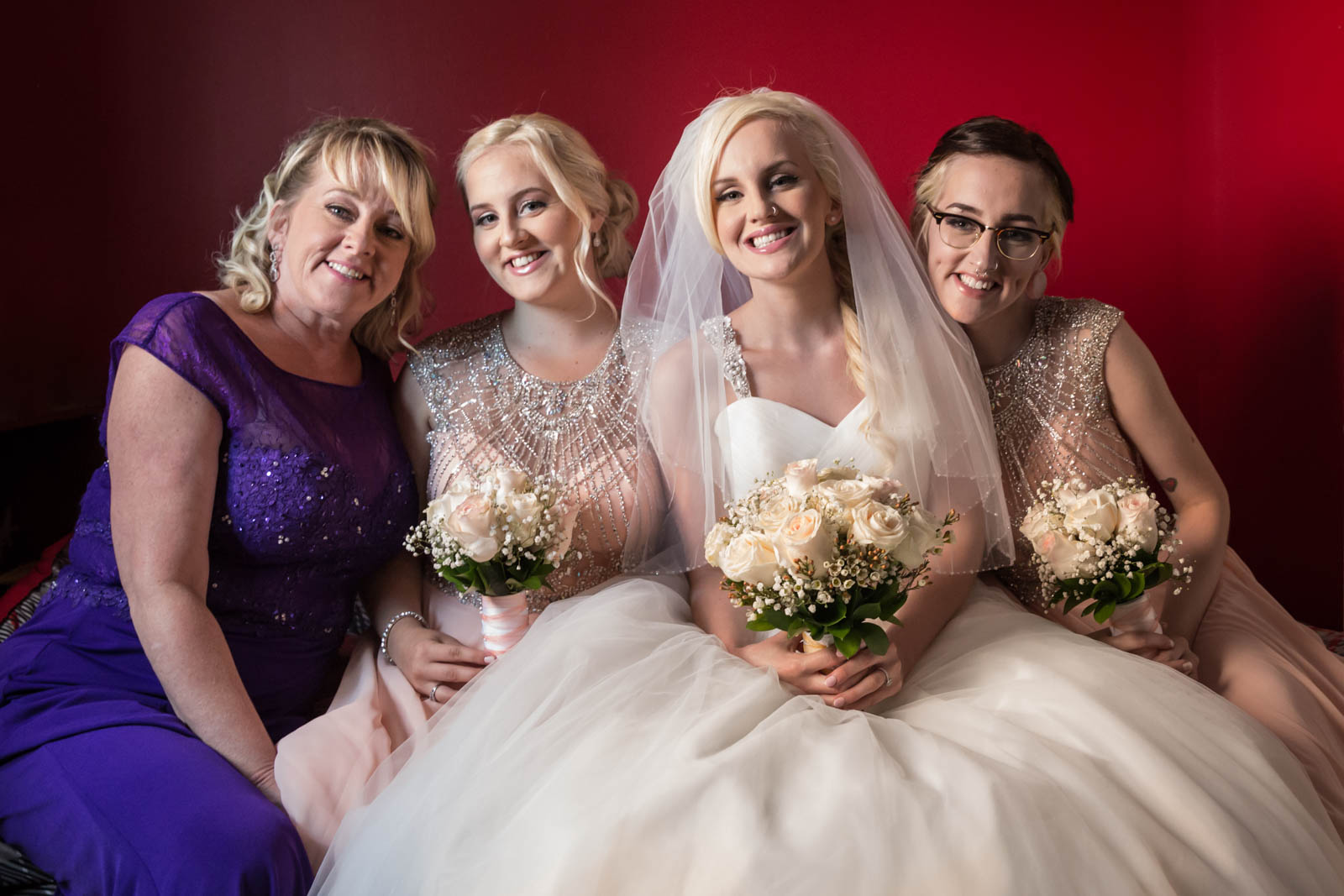 Bride with bridesmaids and mom