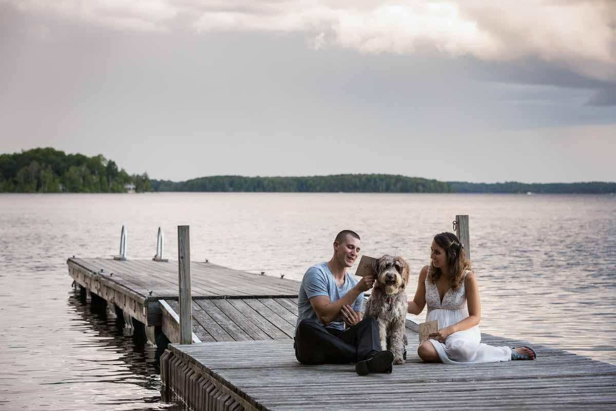 Pixelicious Kc and Quinn wedding Rosebud Resort exchange vows on docks with dog