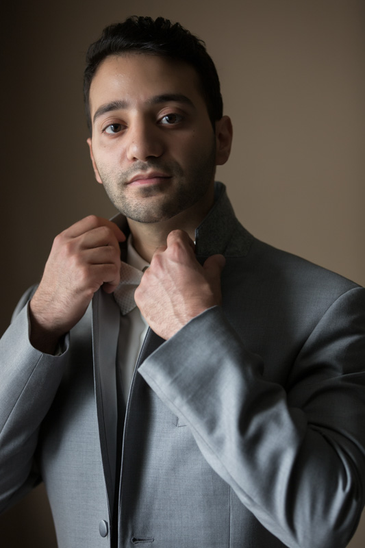 Groom holding the suit's collar