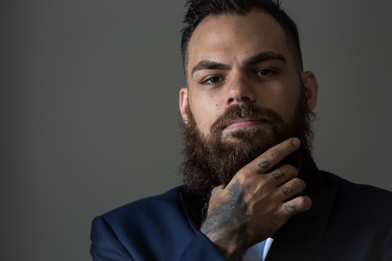 Groom featuring tattooed hand and beard