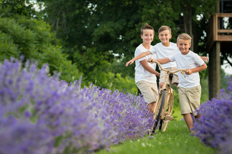 Three boys riding bike