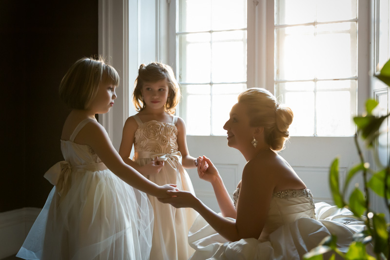 Bride holding daughters' hands
