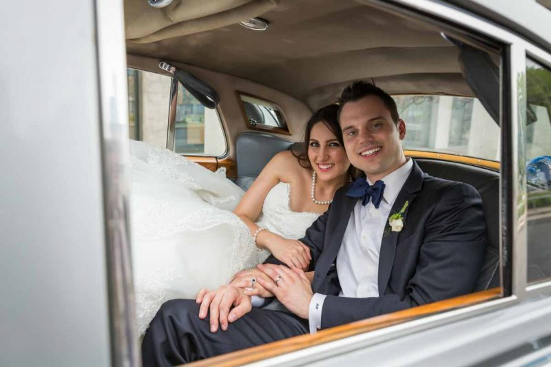 Bride and groom in limousine