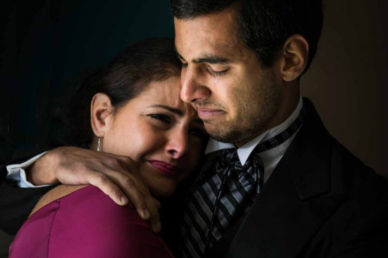 Groom and Mom crying during preparation
