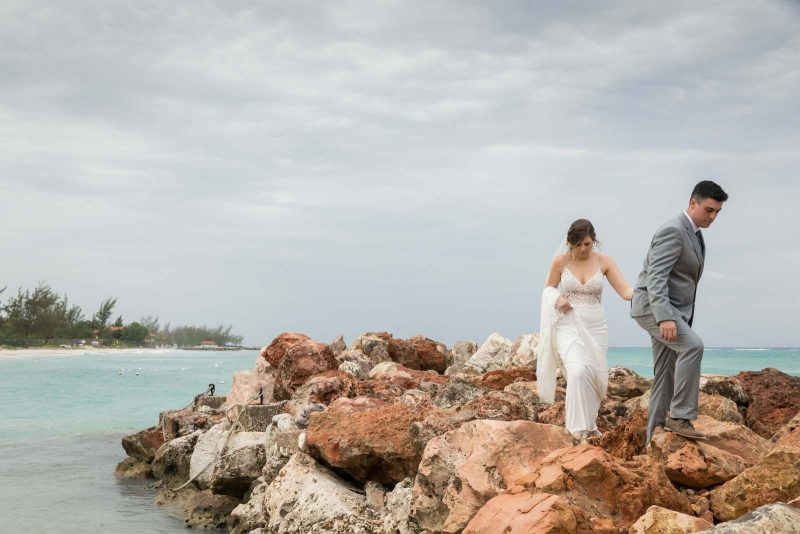 Newlyweds walking on rocks