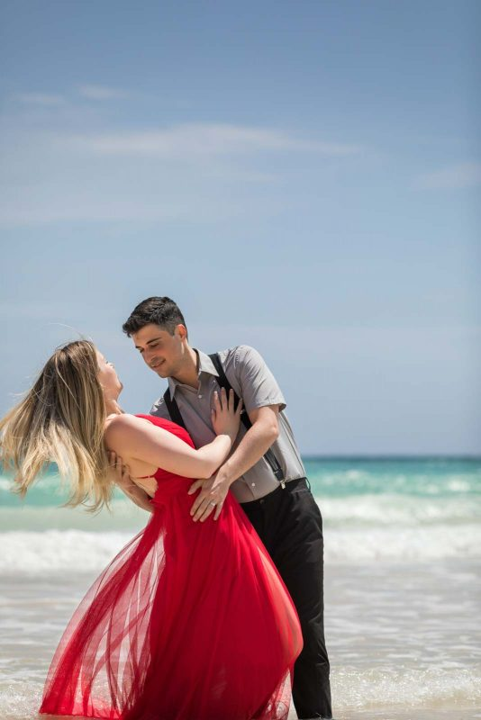 Newlyweds dancing on beach