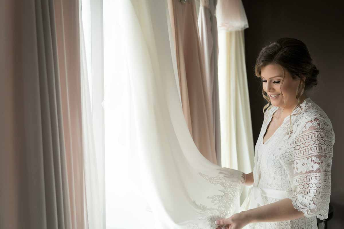 Bride overlooking at wedding dress