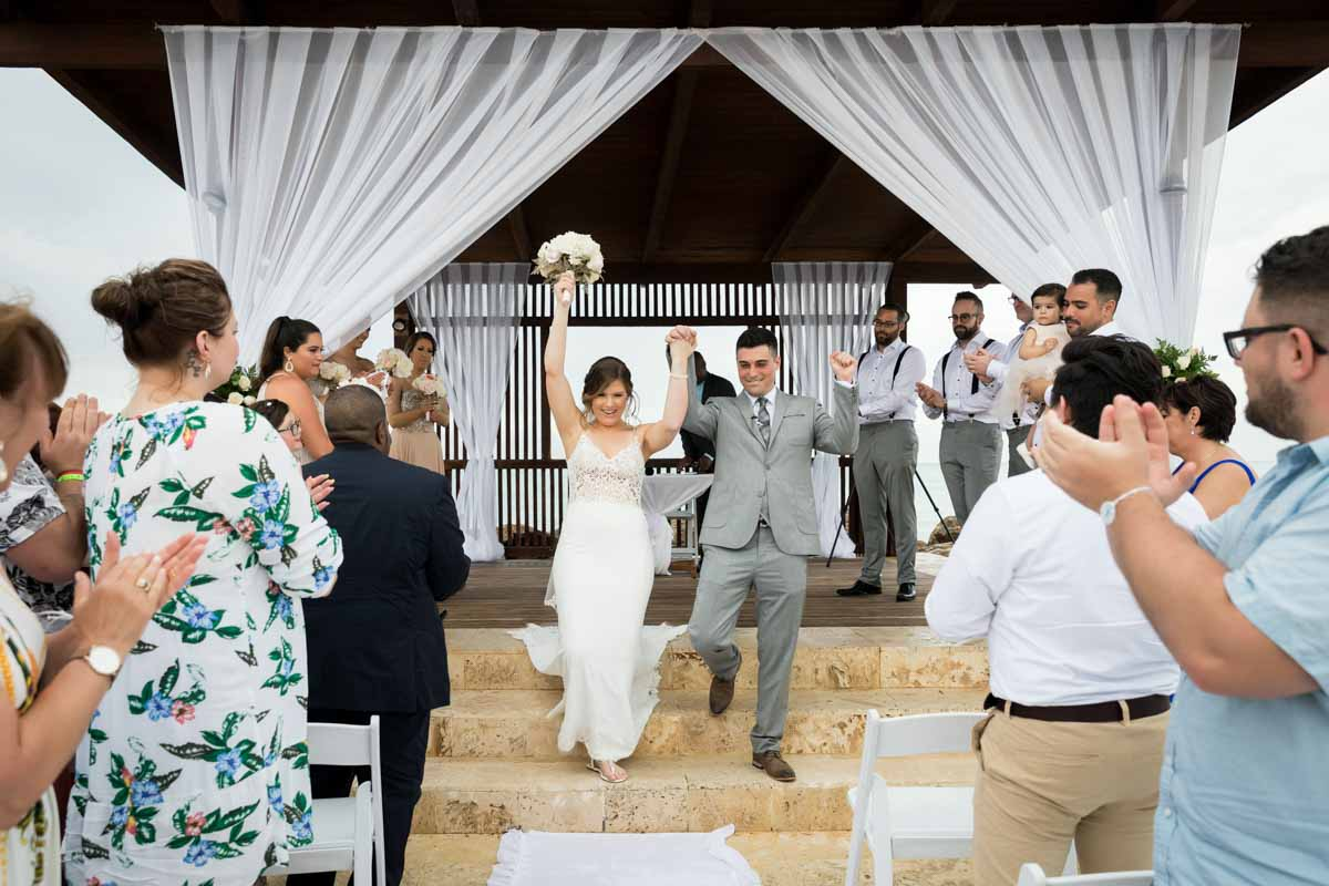 Newlyweds celebrating after ceremony