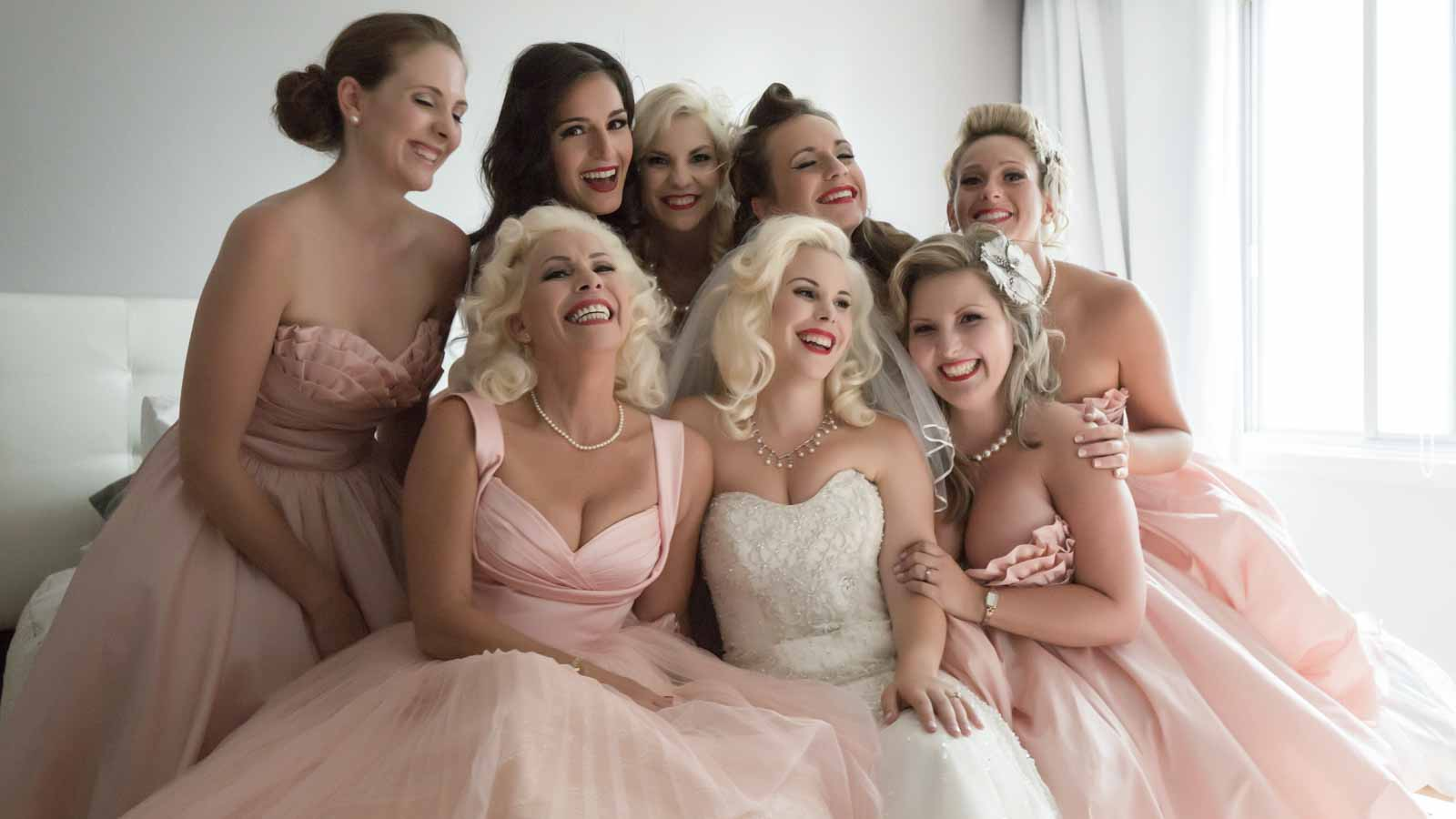 Bridesmaids taking group picture during preparation