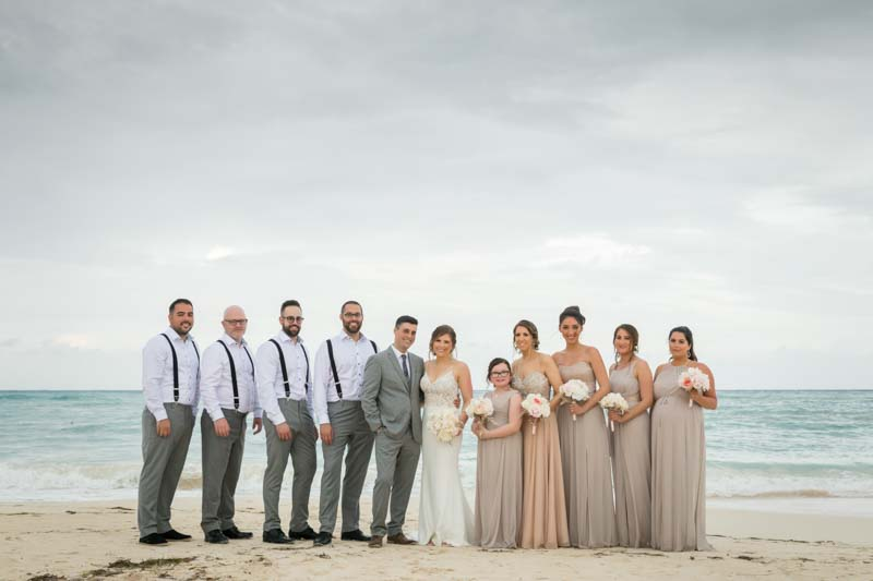 Group picture of wedding party on the beach