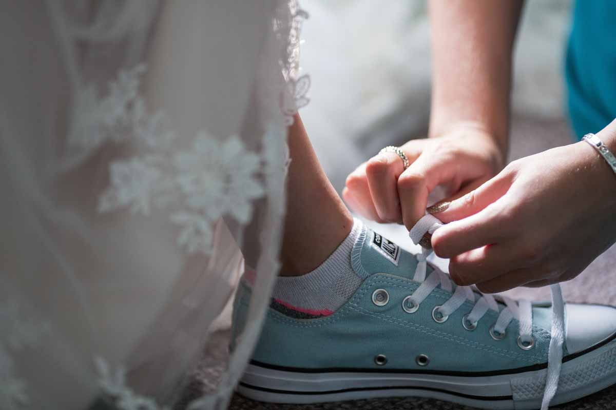 Puma socks and Converse shoes with wedding dress