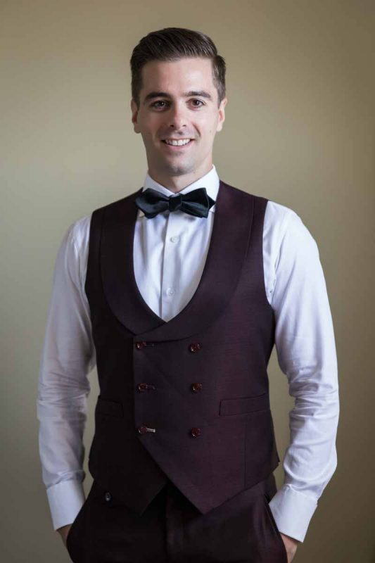 Groom portrait wearing vest