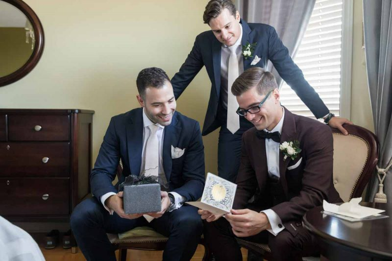 Groomsmen presenting card and gift