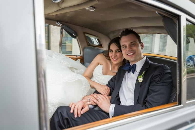 Bride and groom inside limousine